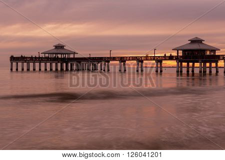 Evening light on the fishing pier in Fort Myers Beach Gulf of Mexico Coast Florida.