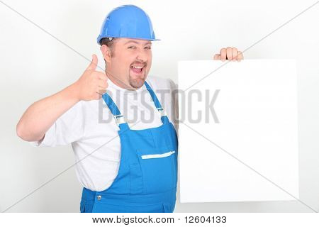 Portrait of a worker with white panel