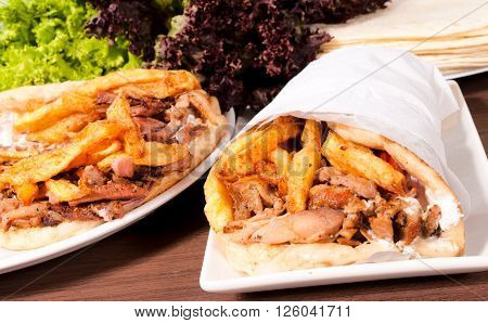 Doner kebabs on the plates on rustic background