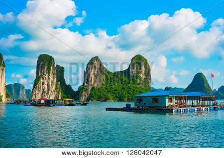Floating village near rock islands in Halong Bay, Vietnam, Southeast Asia. UNESCO World Heritage Site.