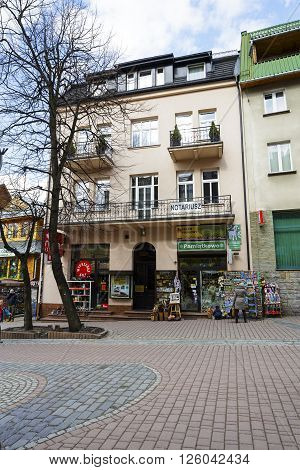 ZAKOPANE POLAND - MARCH 09 2016: Townhouse was built of brick approx. 1920 is located at Krupowki street. It is registered in the municipal register of architectural monument