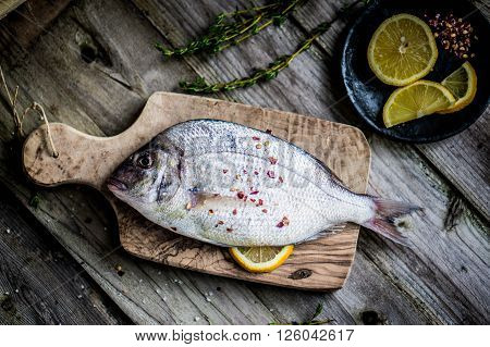 Image of Fresh Sea Bream On Wooden Board