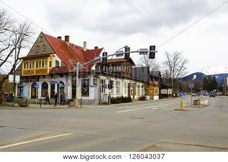 ZAKOPANE POLAND - MARCH 06 2016: Villa Ochotnicki building dating from 1910 partly made of brick and partly built of wood listed in the municipal register of architectural heritage