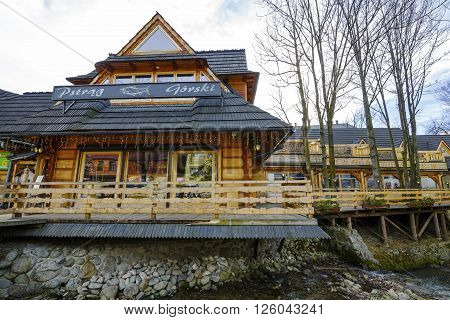 ZAKOPANE POLAND - MARCH 06 2016: The wooden building built in architectural style of the region is well-known restaurant specializing in fish dishes