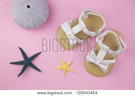 overhead of a pair of baby girl sandals