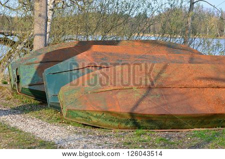 old metal boat on the shore of the pond South Bohemia Czech Republic ** Note: Soft Focus at 100%, best at smaller sizes