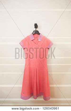one red dress on hanger in a boutique