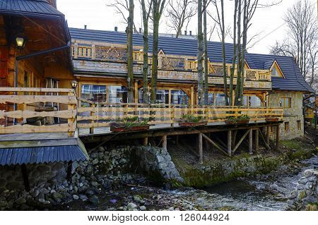 ZAKOPANE POLAND - MARCH 09 2016: The wooden building built in architectural style of the region is well-known restaurant specializing in fish dishes