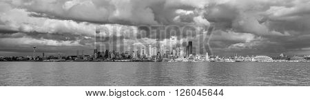 A view of the Seattle skyline across Elliott Bay. Black And white image.