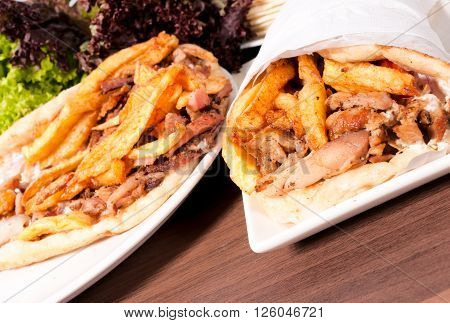 Portions of gyros on the table on rustic background