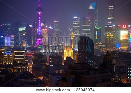 SHANGHAI CHINA - MARCH 19 2015: Famous skyscrapers of Shanghai Pudong commercial district at night.