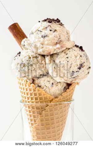 Stracciatella ice creams in coneselective focus on rustic background