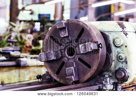 Old lathe machine in factory, head stock