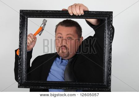 Portrait of a businessman with wooden frame