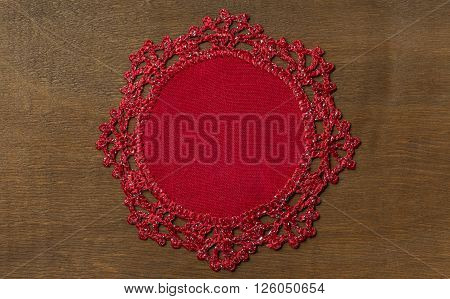 Hand-Knitted linen table napkin handmade on wood background