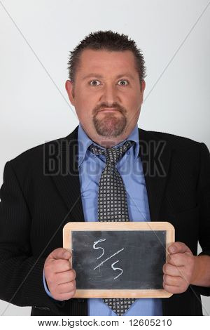 Portrait of a businessman in police custody