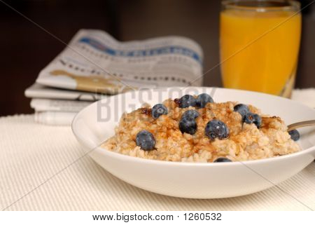 Bowl Of Oatmeal With Brown Sugar, Blueberries, Orange Juice