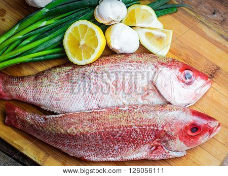 Fresh Red Snapper Preparation With Lemon And Vegetables