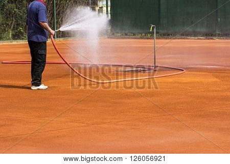 The Person for maintenance sprinkler tennis court
