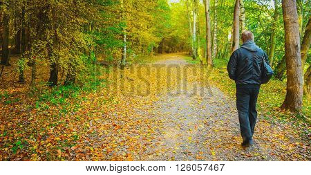 Old man outdoors. Autumn time. Old man