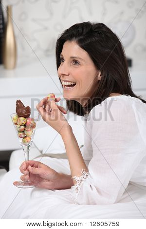 Portrait of a woman eating Easter eggs
