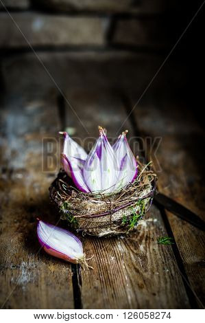 Halved Red Onions In A Basket On Rustic Background