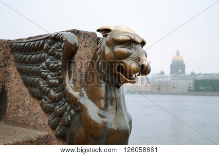 Four of Griffin located on the sides of the granite pier Universitetskaya embankment (Saint-Petersburg) on the Neva river