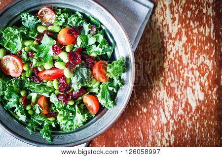 Kale And Edamame Salad On Rustic Background