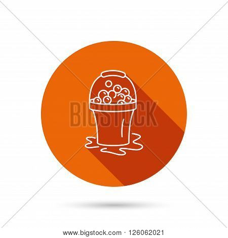 Soapy cleaning icon. Bucket with foam and bubbles sign. Round orange web button with shadow.