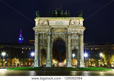 Arch of Peace (Porta Sempione) at night in Milan Italy