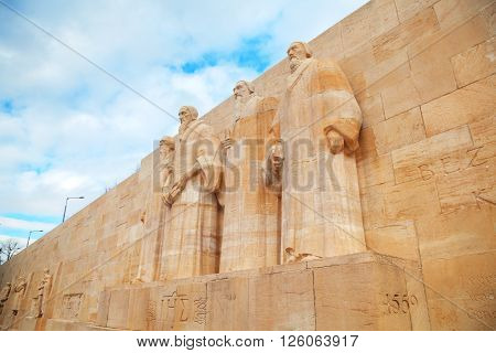 GENEVA SWITZERLAND - NOVEMBER 28: The International Monument to the Reformation (Reformation wall) with the statues of Farel Calvin Beza and Knox on November 28 2015 in Geneva Switzerland.