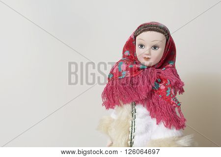National clothes on dolls. Fragments of ethnic patterns on clothing.