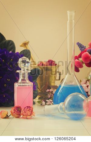 Dry flowers and vials  of tincture or oil, aromatherapy concept, retro toned