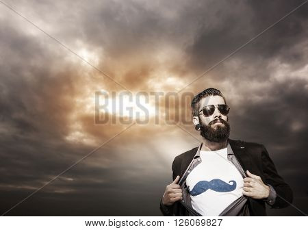 young hipster superhero monitors under a dark sky