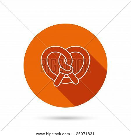 Pretzel icon. Bakery food sign. Traditional bavaria snack symbol. Round orange web button with shadow.