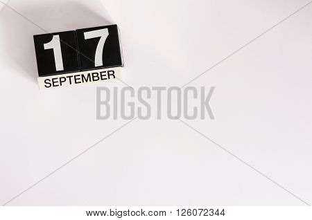 September 17th. Image of september 17 wooden office calendar on white background. Autumn day. Empty space for text.