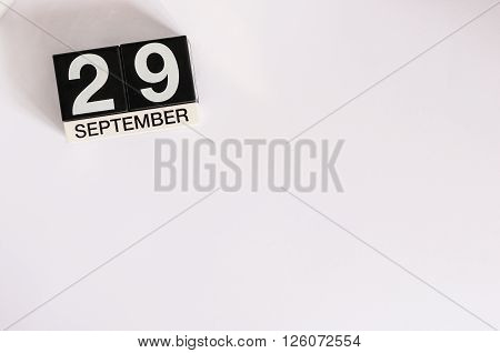 September 29th. Image of september 29 wooden office calendar on white background. Autumn day. Empty space for text.