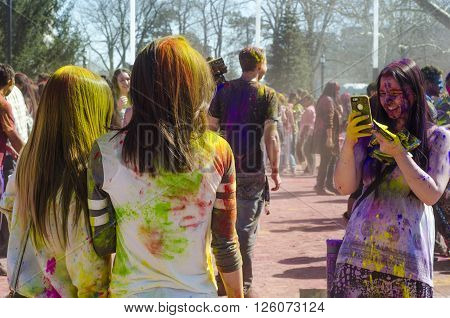 London Ontario, Canada - April 16:  Unidentified Young Colorful Girls Taking Photos With The Phone A