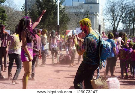 London Ontario, Canada - April 16:  Unidentified Young Colorful Guys Having Fun, Dancing Adn Taking