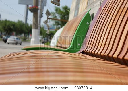 Wooden laths on a seat mat and on a back of a city shop