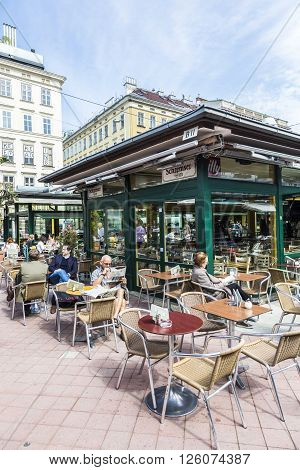 VIENNA AUSTRIA - APR 28 2015: people enjoy the Naschmarket in Vienna. Since the 16th century people in Austria has come to the Naschmarkt get to enjoy the many different products from local producer.