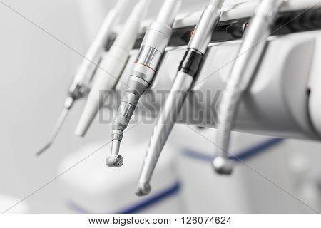 Closeup of a modern dentist tools burnishers with blurred background
