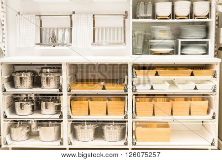 cupboard for a dishes with clean tableware in white colours