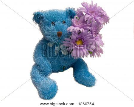 Furry Blue Teddy Bear Holding Flowers
