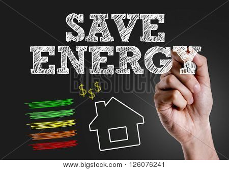 Hand writing the text: Save Energy