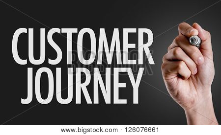 Hand writing the text: Customer Journey