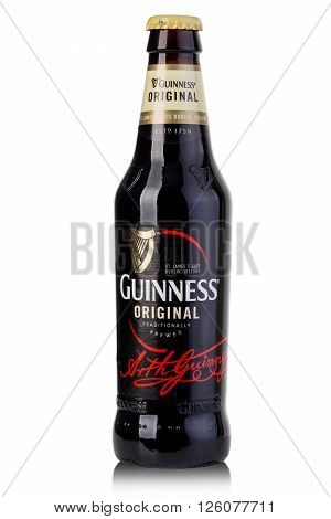CHISINAU MOLDOVA - Ferbruary 05 2016: A bottle of Guinness beer on a white background. Guinness is one of the most successful beer brands worldwide.