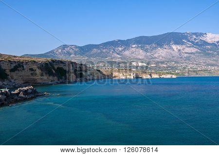 Cliff coast of Kefalonia island in afternoon sun Greece