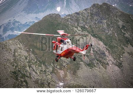 Zako pane, Poland-July 4 2015:Helicopter mountain rescue service in the High Tatras.