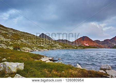 Red Sunset at Kamenitsa Peak And Tevno lake, Pirin Mountain, Bulgaria